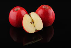 Three red apples  isolated on black Stock Photo
