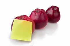 Three red apples with stiker note Stock Images