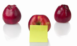 Three red apples with stiker note Royalty Free Stock Photo