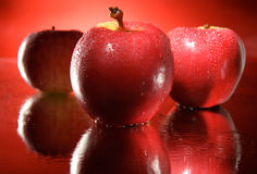 Three red apples team Stock Photography
