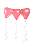 Three red balloons in the shape of a heart Stock Photo
