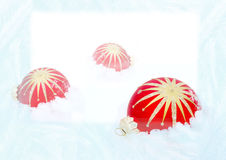Three red  balls on snow Royalty Free Stock Photography