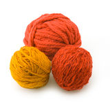 Three red balls of threads Royalty Free Stock Photography