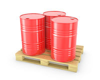 Three red barrels on a pallet Royalty Free Stock Images