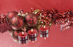 Three red baubles with tealights Royalty Free Stock Image