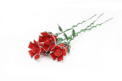 Three red beaded roses at a diagonal Stock Photography