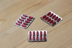 Three red blister pack capsule Stock Photo