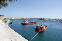 Three red boats in Valletta harbour, Malta Royalty Free Stock Images