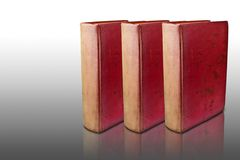 Three red books on reflected floor Stock Photo