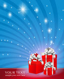 Three red boxes with silver ribbons Stock Image