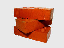 Three red bricks on a white background Stock Photos