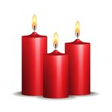 Three red burning candles on white background. Stock Photos