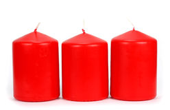 Three red candle wax on a white background Stock Image