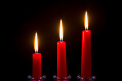 Three red candles on a black background Royalty Free Stock Image