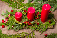 Three red candles in a Christmas arrangement Stock Photo