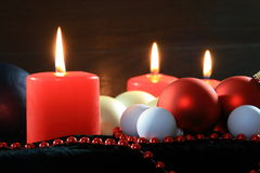 Three red candles christmassy Stock Images