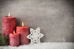 Three red candles on gray background, Christmas decoration. Adve Stock Photography
