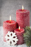 Three red candles on gray background, Christmas decoration. Adve Royalty Free Stock Images