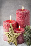 Three red candles on gray background, Christmas decoration. Adve Royalty Free Stock Photo