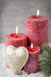 Three red candles on gray background, Christmas decoration. Adve Royalty Free Stock Image