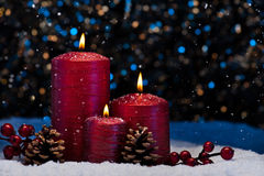 Three Red Candles in snow Royalty Free Stock Image
