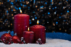 Three Red Candles in snow Royalty Free Stock Photo