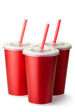 Three red cardboard cups with a straws Royalty Free Stock Image
