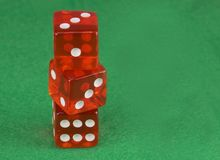 Three red casino dices on green cloth. The concept of online gambling. Copy space for text. Red casino dices on green cloth. The concept of online gambling stock photo