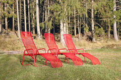 Three red chairs Stock Images