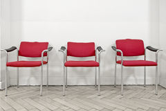 Three red chairs Stock Photos