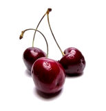 Three red cherries Stock Image