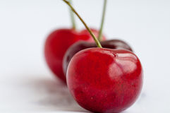 Three red cherry on a white background Royalty Free Stock Image