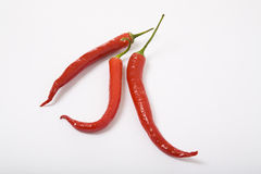 Three red chili peppers Stock Photo