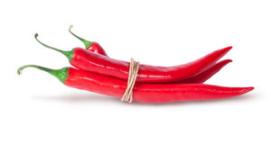 Three red chili peppers tied with a rope Stock Photos