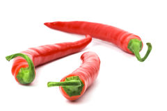 Three red chilly peppers Royalty Free Stock Photo
