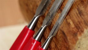 Three red chisels with different length Royalty Free Stock Photography