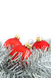 Three red Christmas balls. With silver decoration on white background stock photo