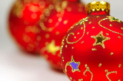 Three red christmas balls. White background royalty free stock photo