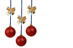 Three red Christmas balls with golden bows Royalty Free Stock Photos