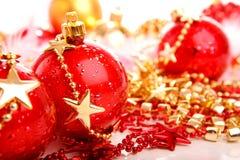 Three red christmas balls on stars Stock Photo