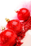 Three red christmas balls on stars isolated Royalty Free Stock Photo