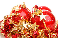 Three red christmas balls on stars isolated. Three red christmas ball baubles on stars decoration isolated over white Royalty Free Stock Photography