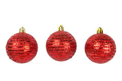 Three red Christmas balls on white Stock Photo