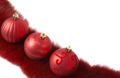 Three red Christmas baubles on fur Stock Photos
