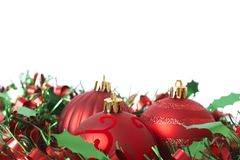 Three Red Christmas baubles on tinsel Royalty Free Stock Photos