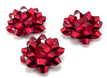 Three red christmas bows Stock Photo