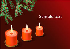 Three red christmas candles. Royalty Free Stock Images