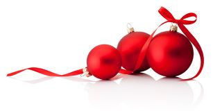Three red Christmas decoration baubles with ribbon bow isolated on white background. Three red Christmas decoration baubles with ribbon bow isolated on a white royalty free stock photos