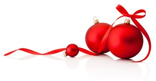 Three red Christmas decoration baubles with ribbon bow isolated. On a white background royalty free stock photo