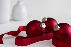 Three Red Christmas Ornaments with Ribbon. Three red Christmas ornaments with red ribbon against an all white background Stock Images